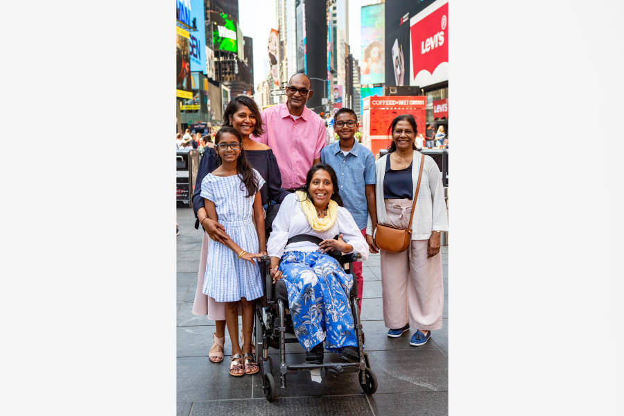 Lakshmee Lachhman-Persad, her sister Annie, and their family in Times Square.