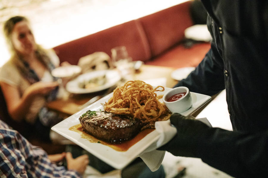 steak being served at Tribeca grill, indoor dining, manhattan, nyc
