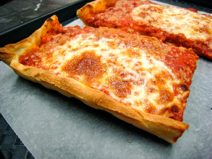 Thin crust sicilian slice from Rizzo's in Astoria Queens