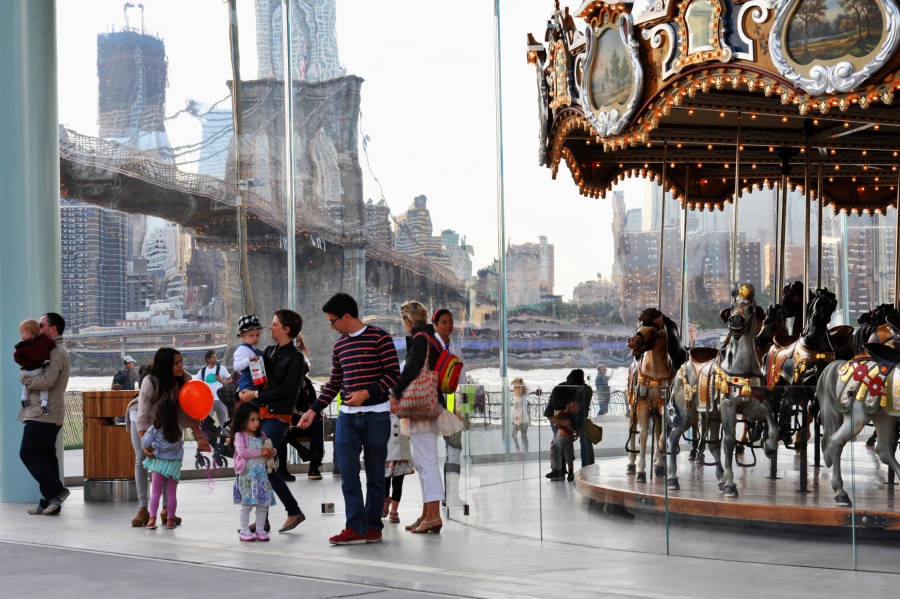 Family visiting Jane's Carousel in Brooklyn Bridge Park.