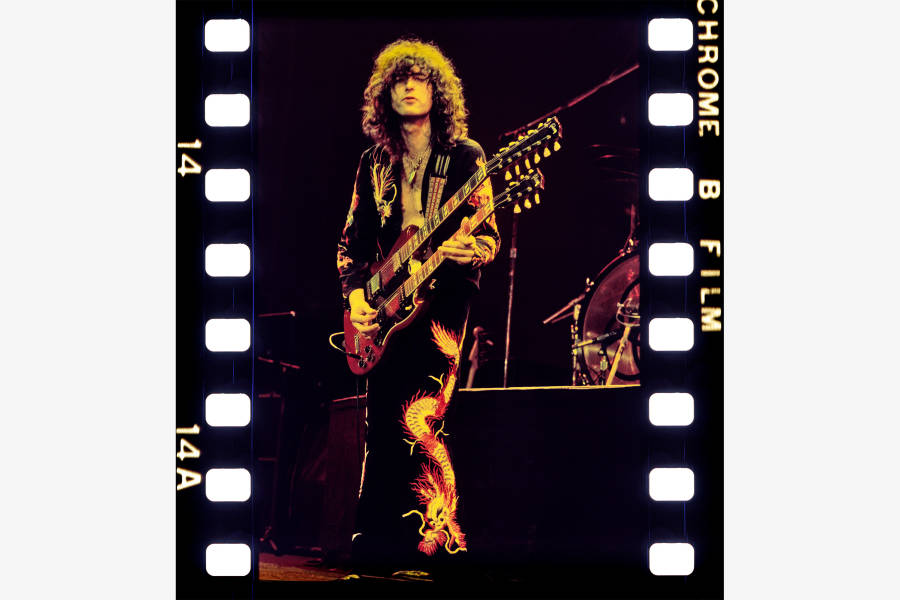Jimmy Page wearing dragon-embroidered jacket and pants and with his EDS-1275 double-neck guitar in this photo are featured in the exhibition.Collection of Jimmy Page. Photo: Courtesy of Kate Simon