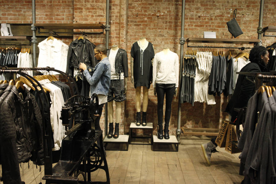 Shoppers inside the interior of AllSaints in Soho Manhattan