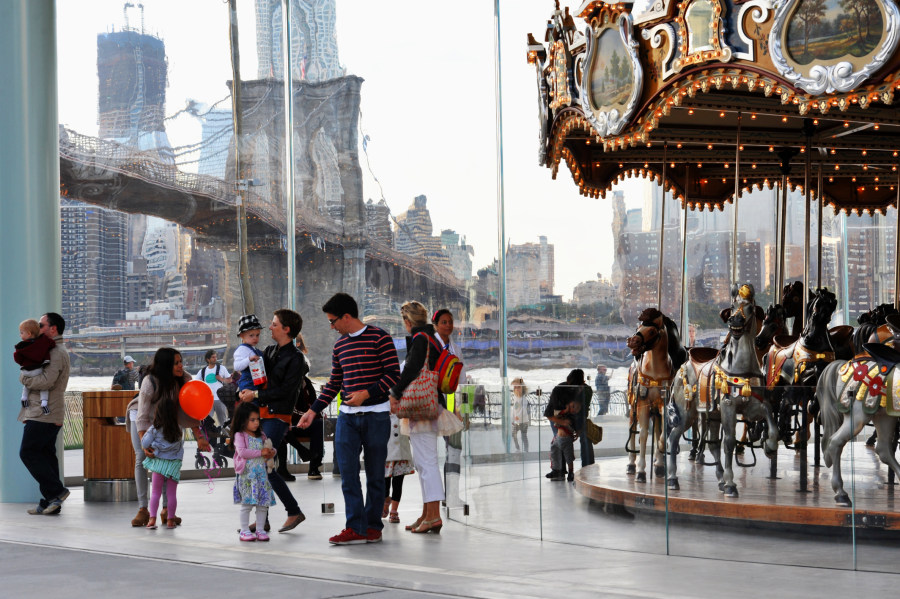 Family visiting Jane's Carousel in Brooklyn Bridge Park.